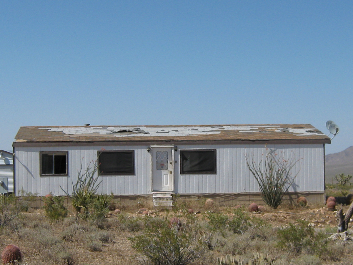 mobile home roof damaged by wind and water